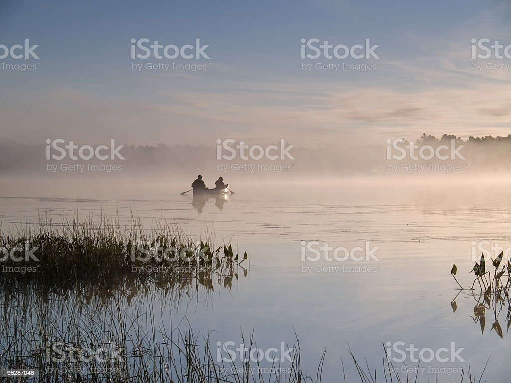 Canoe in Early Morning Mist royalty-free stock photo