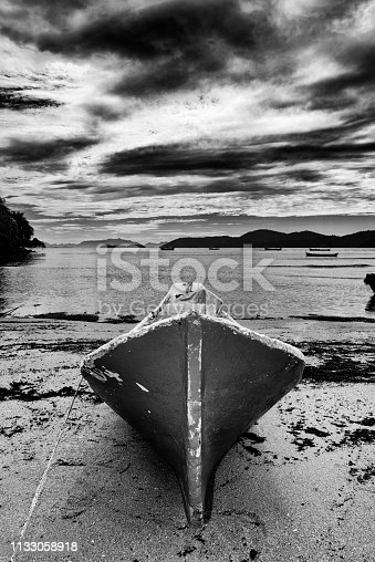 Canoe on the sand of Pontal beach in the bay of Paraty on the southeastern coast of Brazil