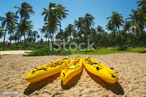 Canoe Kayak boats on sunny tropical beach with palm trees, Punta Cana