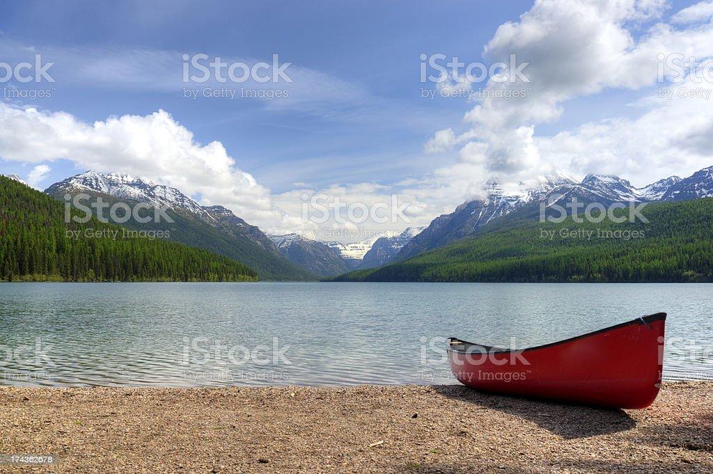 Canoe next to a mountain lake royalty-free stock photo