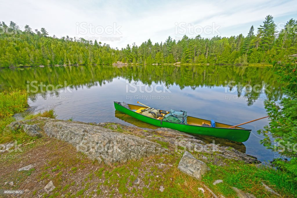 Canoe on a Wilderness Shore stock photo