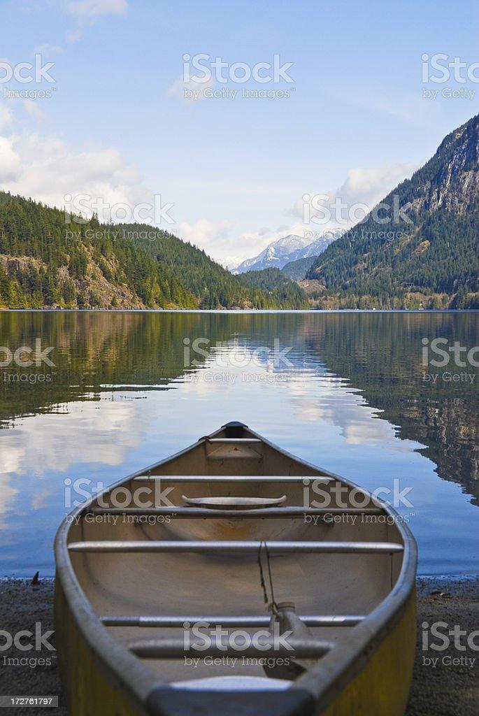 Canoe on lakeshore royalty-free stock photo