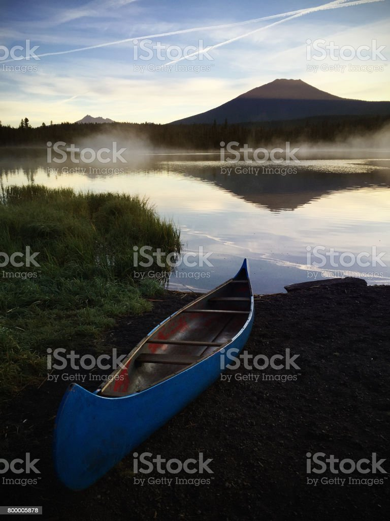 Canoe on the Edge of Little Lava Lake, Oregon at Dawn stock photo