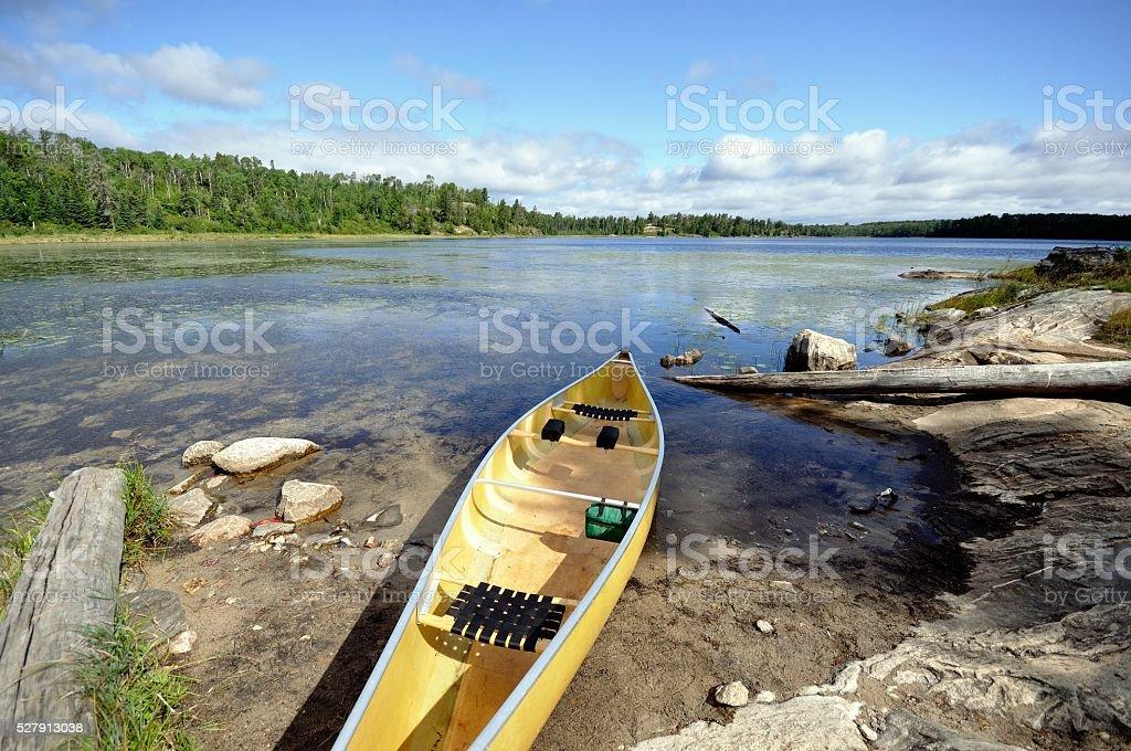 Canoe on the Shore of Wilderness Lake stock photo