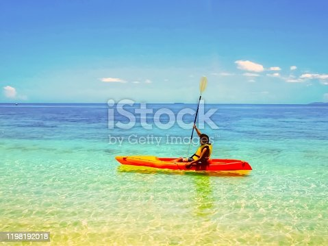 Man in a canoe on the tropical water in Fuji