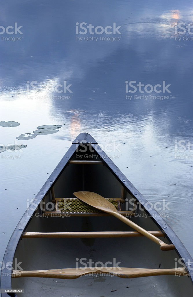 canoe on tranquil lake stock photo