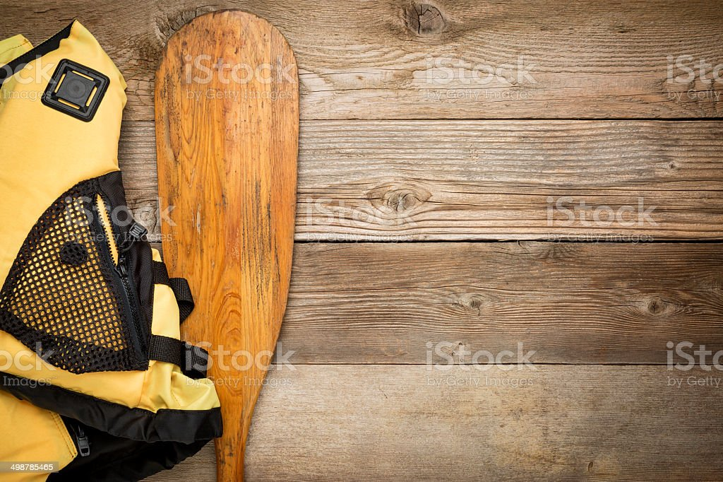 canoe paddle and life jacket stock photo