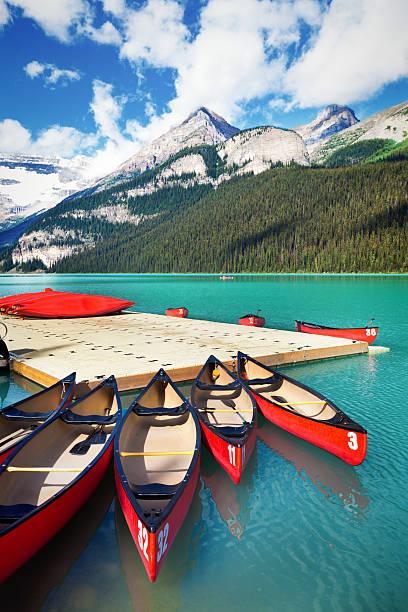 canoe rental service on lake louise of banff national park - lake louise stockfoto's en -beelden