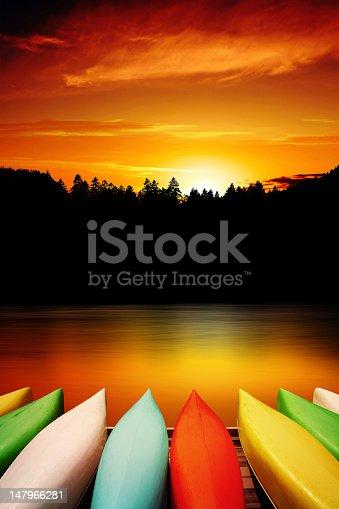184332102istockphoto XXXL canoe sunset 147966281