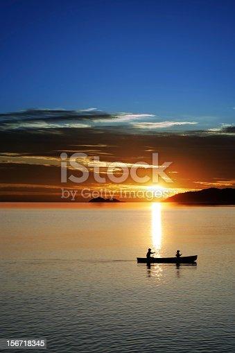 184332102istockphoto XXL canoe sunset 156718345
