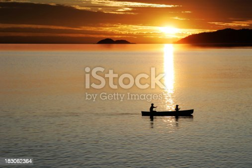 184332102istockphoto XL canoe sunset 183062364