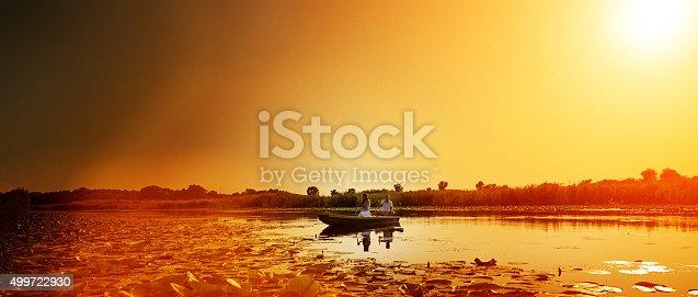 184332102istockphoto canoe sunset 499722930
