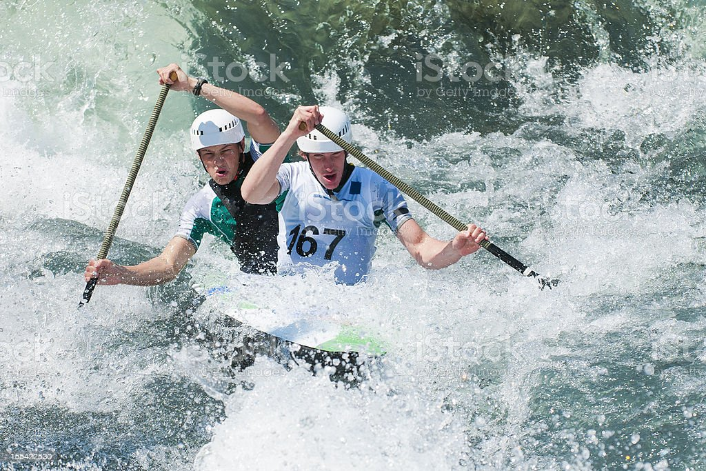 Canoe team in whitewater mist stock photo