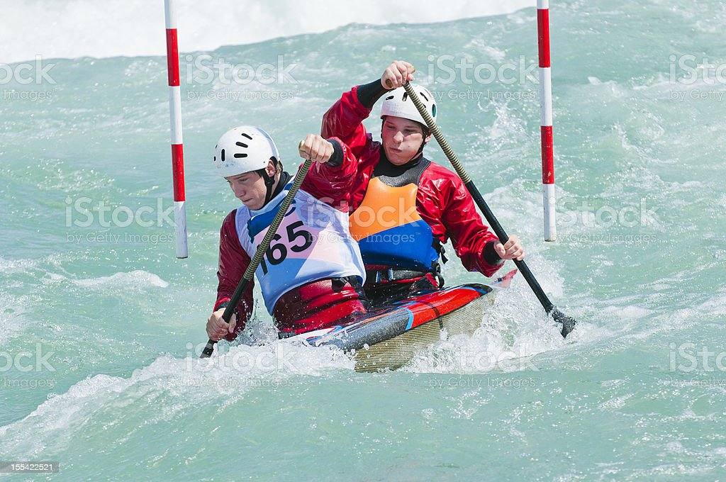 Canoe team passing the red gate stock photo
