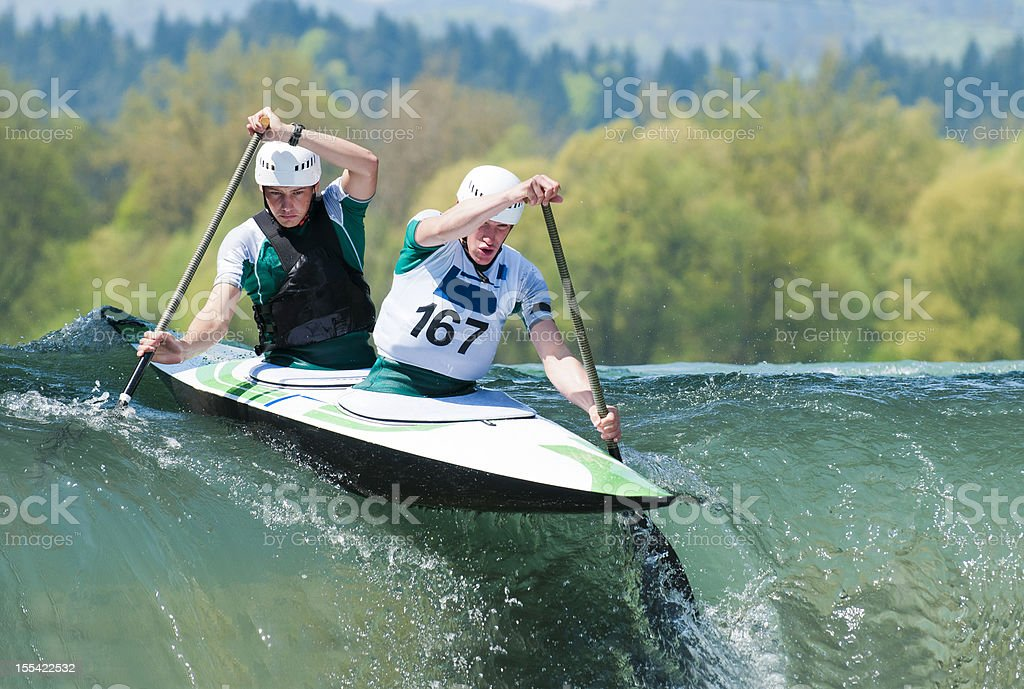 Canoe team starting the race stock photo