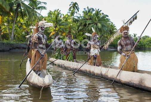 841481956istockphoto Canoe war ceremony of Asmat people. 585078272