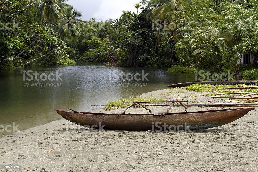 Canoe with tropical forest background stock photo