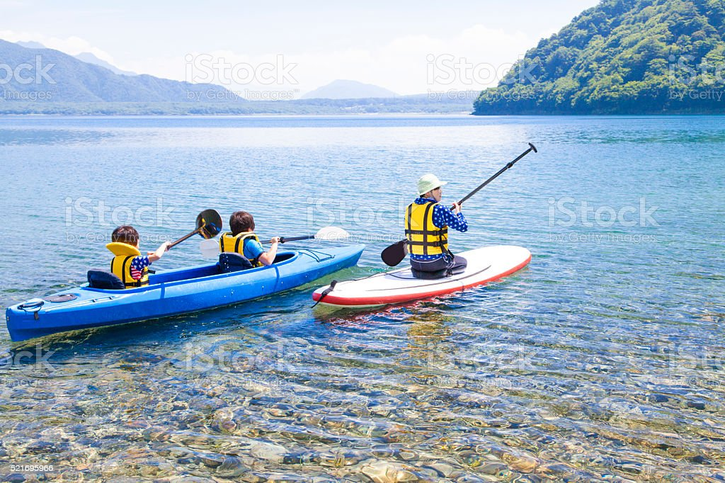 Canoeing and Stand up paddle boarding family stock photo