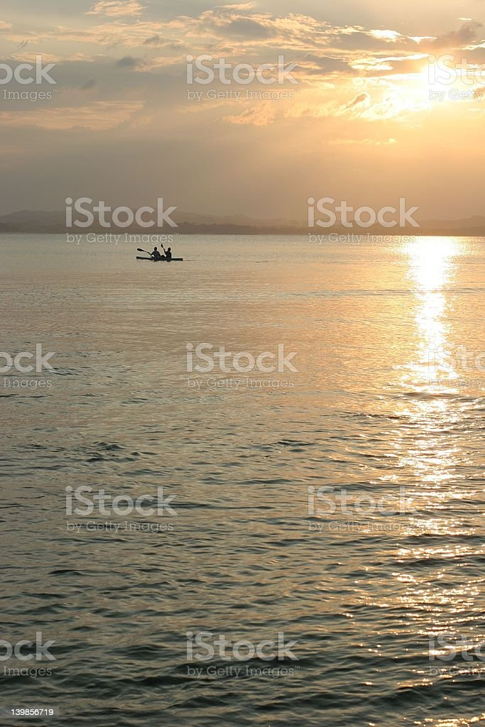 Canoeing at sunset on Pulau Kapas stock photo
