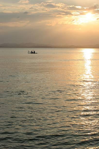 Canoeing at sunset on Pulau Kapas stock photo