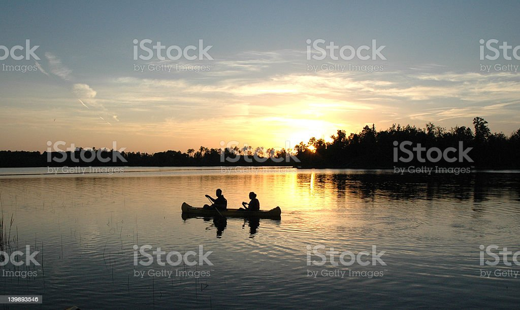 Canoeing at the lake. stock photo