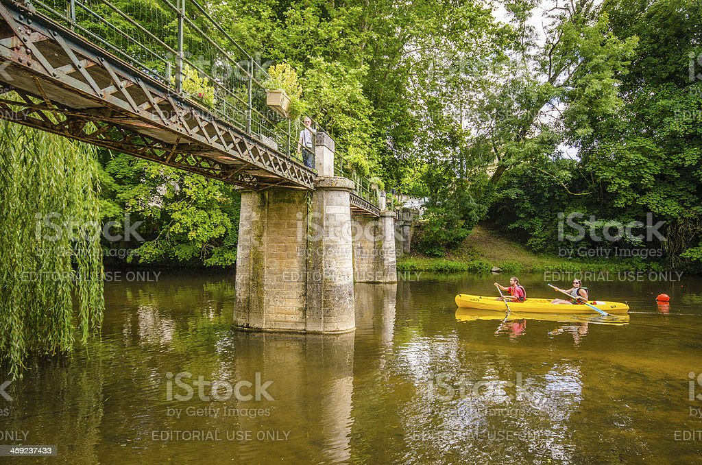 Canoeing by the bridge. royalty-free stock photo