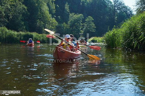 istock Canoeing by the river. Lithuania by the river Minija. 1014080454