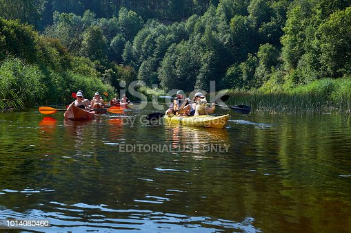 istock Canoeing by the river. Lithuania by the river Minija. 1014080460