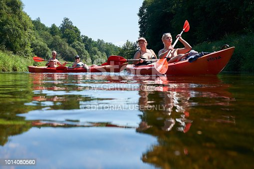 istock Canoeing by the river. Lithuania by the river Minija. 1014080560