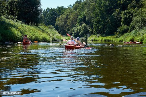 istock Canoeing by the river. Lithuania by the river Minija. 1014080566