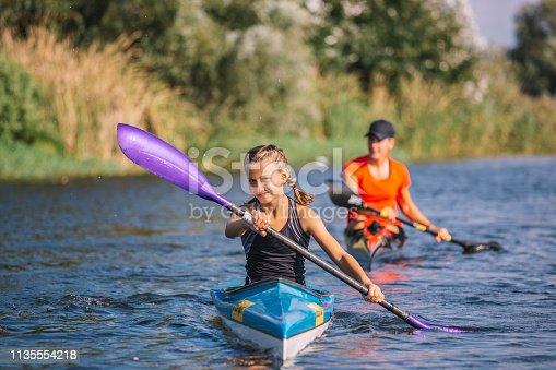 Master kayaking on the river or lake to train children. Together enjoy rowing and kayaking.