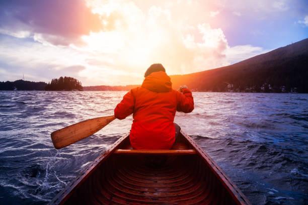 Canoeing during vibrant Sunset