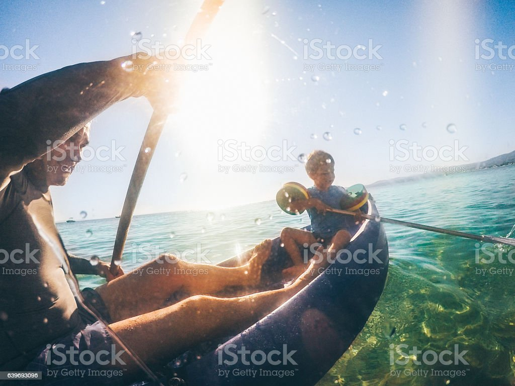 Canoeing in the sea stock photo