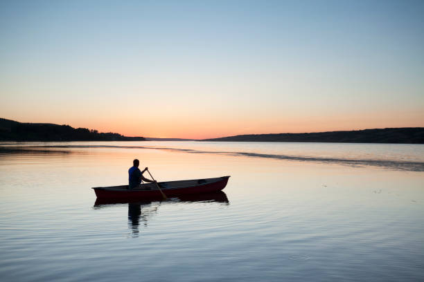 Canoeing In To The Sunset At Buffalo Pound Provincial Park Saskatchewan Canada stock photo