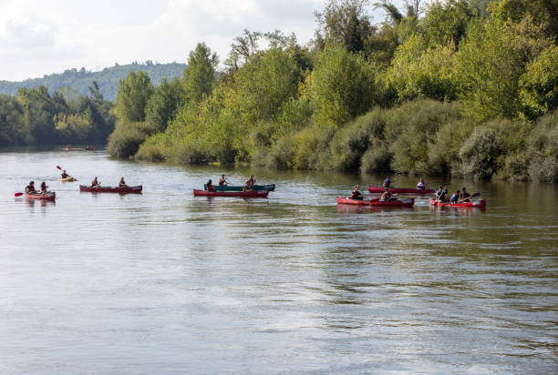 Canoeing on Dordogne river in La Roque-Gageac, Aquitaine, France stock photo