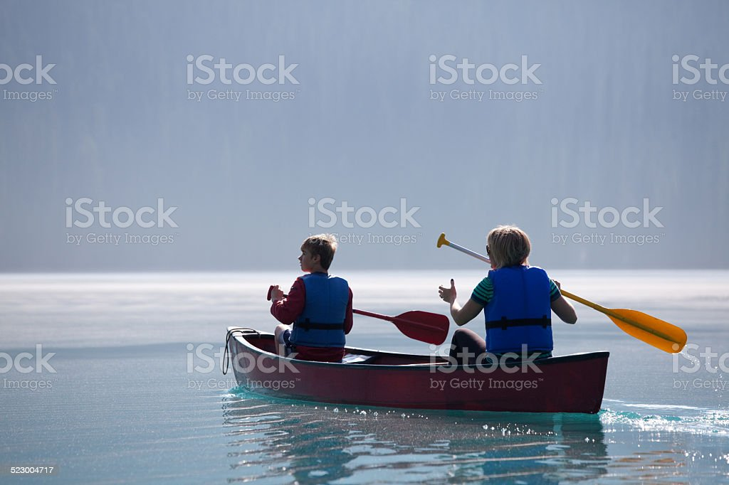 Canoeing on Emerald Lake stock photo
