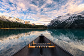 Canoeing on Maligne lake with canadian rockies reflection in Spirit Island at Jasper national park, Canada
