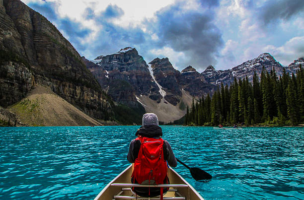 canoeing on moraine lake - canada stockfoto's en -beelden