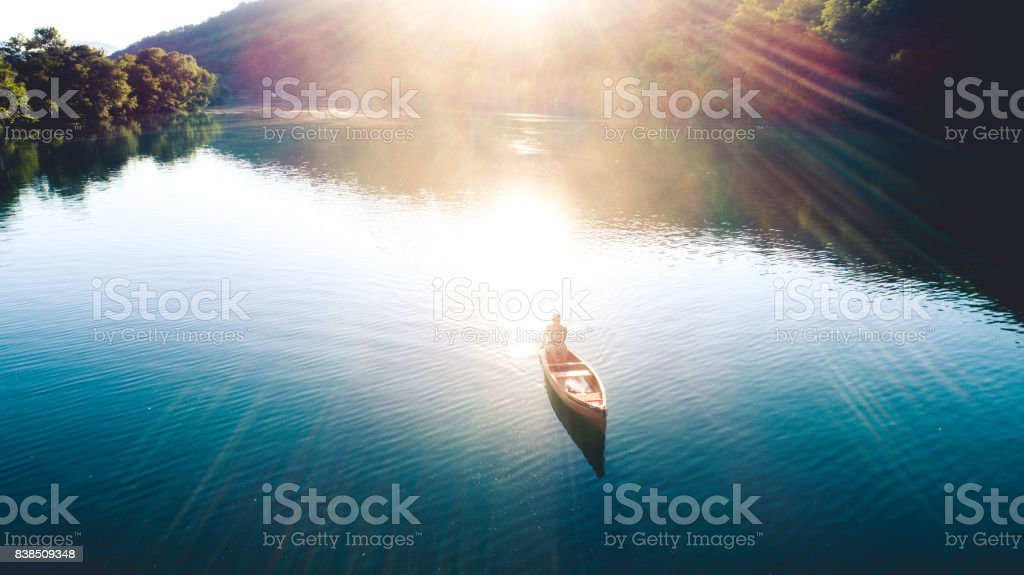Canoeing on sunset stock photo