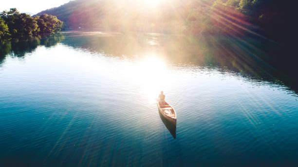 Canoeing on sunset stock photo