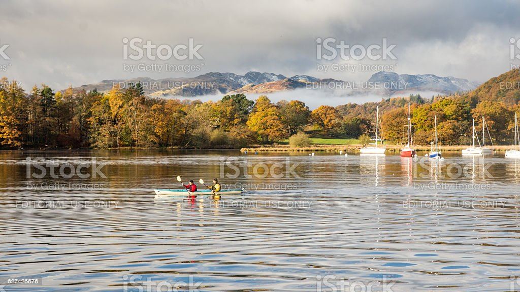 Canoeing on Windermere lake stock photo