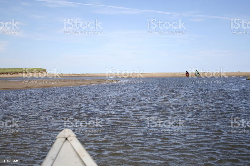 canoeing to the beach royalty-free stock photo