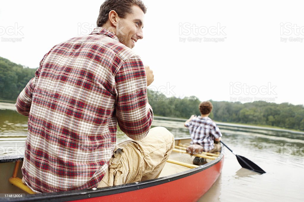 Canoeing with his son royalty-free stock photo