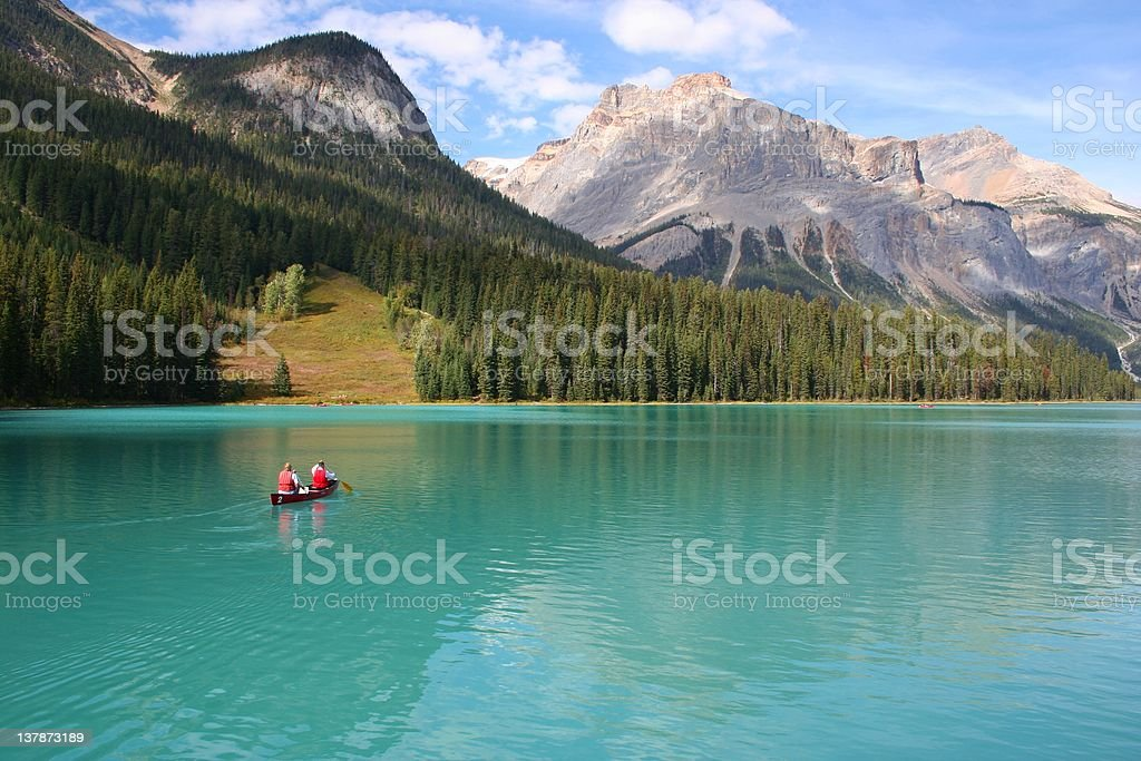 Canoeists on Emerald Lake Canoeists on Emerald Lake in the Canadian Rockies Alberta Stock Photo