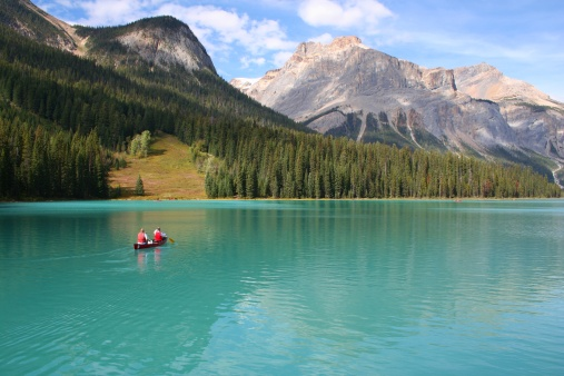 Canoeists On Emerald Lake Stock Photo - Download Image Now
