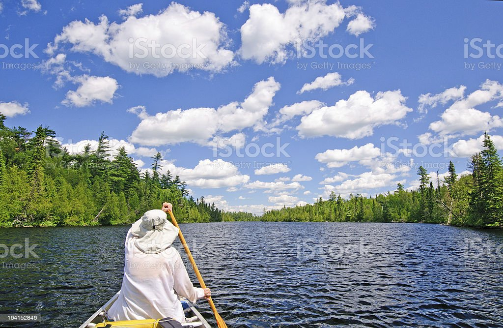 Canoer on a Lake in the North Woods stock photo