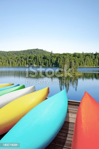 184332102 istock photo XXL canoes and lake 183218391