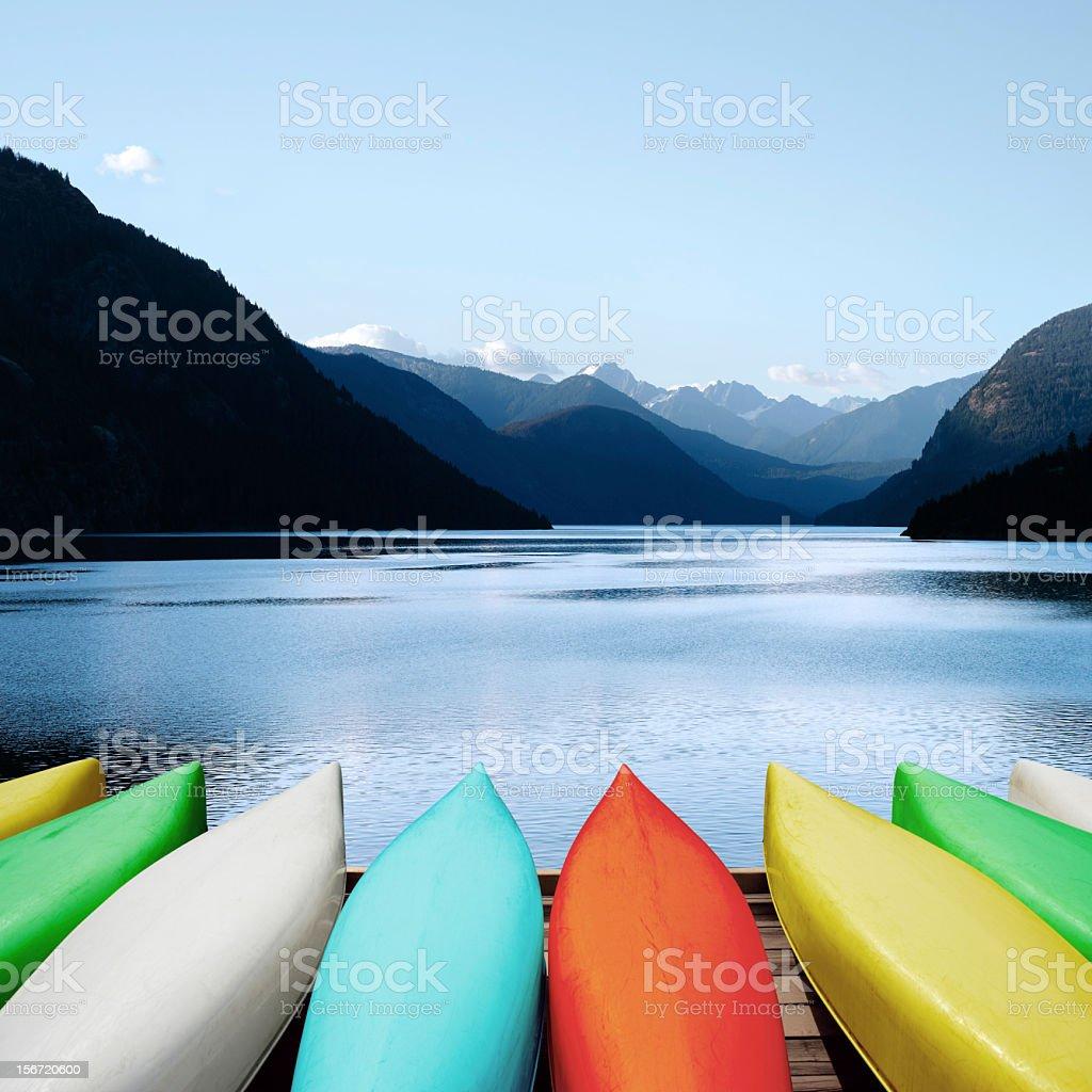 XXXL canoes and mountain lake stock photo