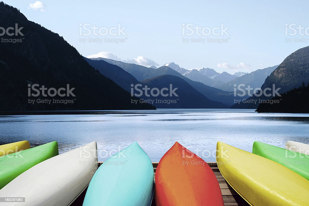 XL canoes and mountain lake stock photo