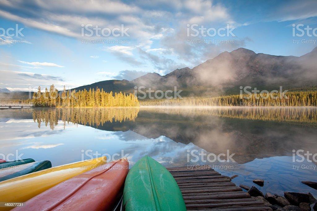 Canoes at Mountain Lake stock photo